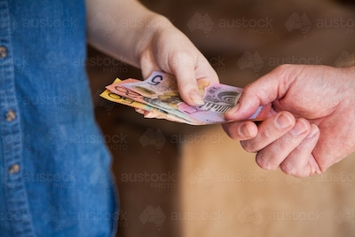 Sm people handing over australian money notes in payment austockphoto 000069934